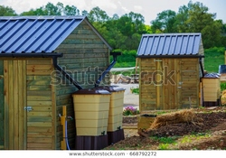 green-recovery-rainwater-outside-town-600w-668792272